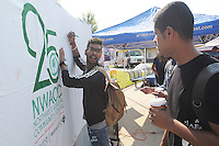 NWA Democrat-Gazette/FLIP PUTTHOFF<br /> GOAL SETTERS<br /> Ziyad Alsuhaymi (cq) (left) and Sultan Almutairi (cq) put in writing their goals for the semester on a poster during Student Welcome Week activties on Wednesday at Northwest Arkansas Community College. The event featured games, food, vendor exhibits and information about NWACC programs. The college's Student Ambassador and Activities Board organized the event. &quot;It's an opportunity for students to have fun and get acquainted with the college,&quot; said Becky Hudson, director of student life. Welcome festivities continue today at the college.