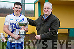 Dermot Walsh of Walsh's SuperValu Cahersiveen presenting the Jack Murphy Cup to Conor O'Shea Captain of the St Mary's team.