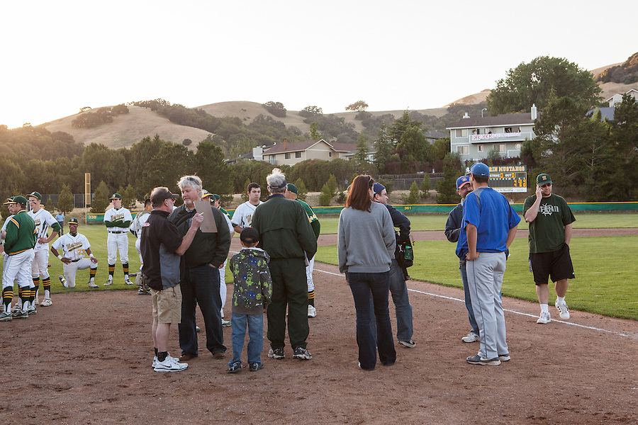 San Marin High School Athletic Director Craig Pitti (far right) seeks answers for how to resume the suspended North Coast Section Division 3 championship game between San Marin and Acalanes High on June 7, 2011.  The final score remained 4-4, when NCS officials later declared both teams Co-champions.