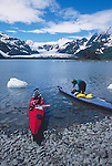 Kayaking, Alaska, Kenai Fjords National Park, Aialik Bay, Sea kayakers launch amidst bergy bits (small ice bergs), David Fox, model released, Feathercraft breakdown sea kayaks,.