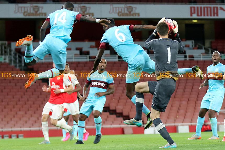 Arsenal goalkeeper, Matt Macey, makes a fine save to thwart a West Ham attack