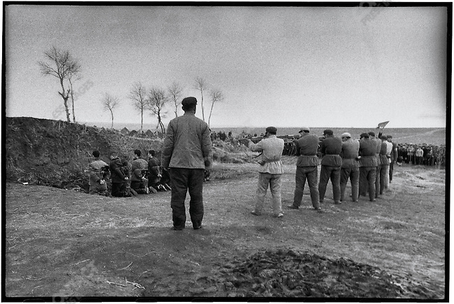 The eight criminals and counter-revolutionaries are forced to kneel on the ground. In the moment before their execution, Outskirts of Harbin, 5 April 1968