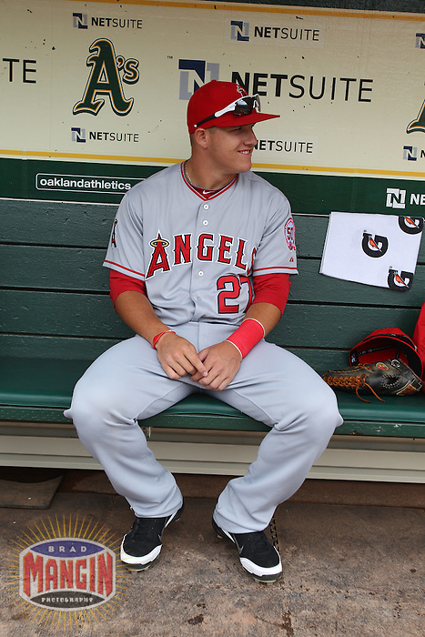 OAKLAND, CA - JULY 16:  Mike Trout of the Los Angeles Angels of Anaheim gets ready in the dugout before the game against the Oakland Athletics at the Oakland-Alameda County Coliseum on Saturday, July 16, 2011 in Oakland, California. Photo by Brad Mangin