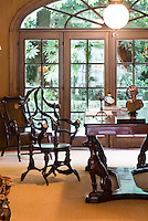 The study is furnished with an eclectic mixture of antique furniture