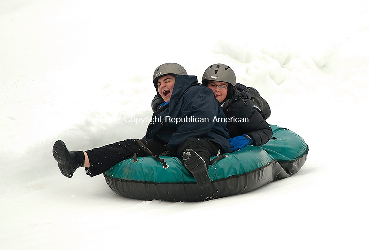 WOODBURY,  CT-122114JS12- Zev Alstock, 14, and his brother Dov Alstock, 13, of New York City, make their way down a tube on Sunday during the annual Chanukah on the Slopes at the Woodbury Ski Area. <br /> Jim Shannon Republican-American