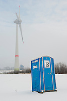 GERMANY Hamburg mobile toilette and Enercon windmill E-126 / DEUTSCHLAND Hamburg ,  Toi Toi Miet Klo vor Enercon Windrad E-126 mit 6 MW in Altenwerder