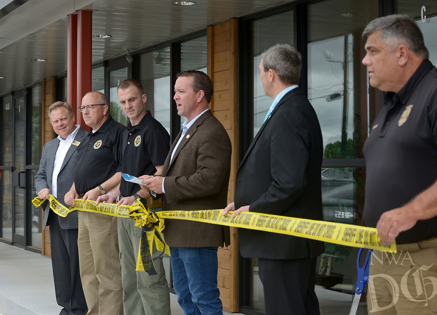 NWA Democrat-Gazette/BEN GOFF @NWABENGOFF<br /> Benton County Sheriff Shawn Holloway (fourth from left) makes remarks Thursday, June 22, 2017, during a grand opening for the new Benton County Sheriff's Office Prairie Creek substation on Arkansas highway 12 near Beaver Lake. The new 1,500 square foot facility will have space for deputies and Arkansas Game and Fish Commission officers to work and store equipment. The sheriff's office already has substations in Siloam Springs, Gravette and Avoca.