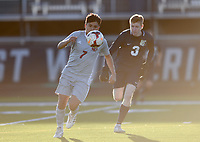NWA Democrat-Gazette/CHARLIE KAIJO Springdale High School midfielder Nelson Barroso (7) dribbles as Bentonville West High School Blake Mcdoulett (3) covers during a soccer game, Friday, March 15, 2019 at Bentonville West in Centerton.