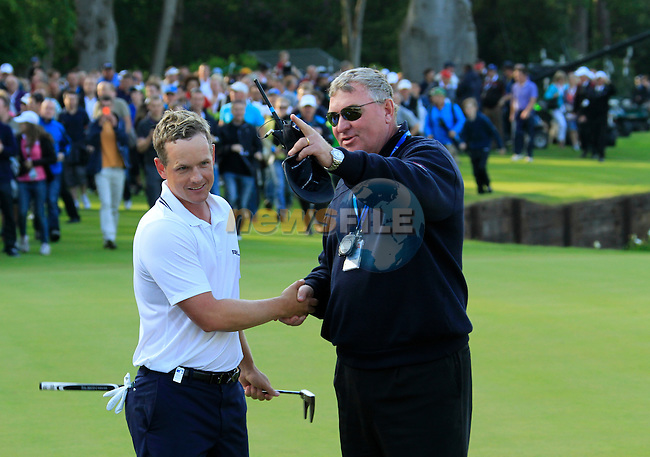 Luke Donald (ENG) gets congratulated by Chief Referee Andy McPhee after winning the tournament and also becoming World No.1 at the end of the Final Day of the BMW PGA Championship at Wentworth Club, Surrey, England, 29th May 2011. (Photo Eoin Clarke/Golffile 2011)