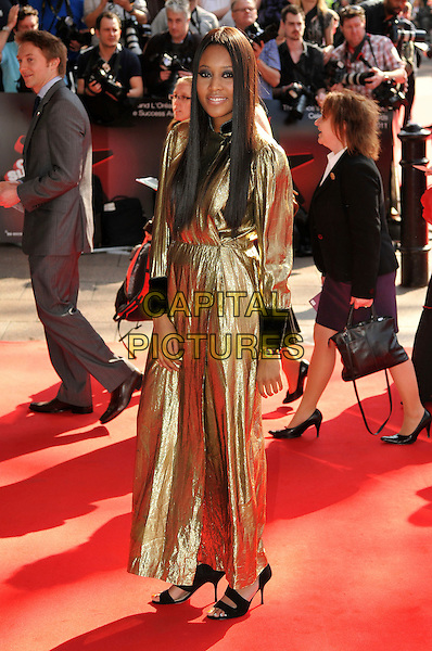 VV BROWN (VANESSA BROWN).The Prince's Trust Celebrate Success Awards at Odeon Leicester Square, London, England..March 23rd, 2011.full length black cuffs gold dress metallic maxi long sleeve .CAP/CJ.©Chris Joseph/Capital Pictures.