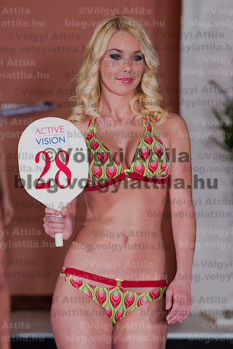 Viktoria Vecsei participates the Miss Hungary beauty contest held in Budapest, Hungary on December 29, 2011. ATTILA VOLGYI