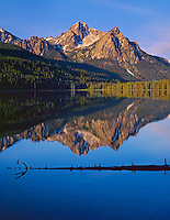 Sawtooth NRA: ID: Morning light on the peaks of Mount McGown with reflections on Stanley Lake