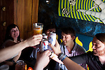 Sondre Lerche drinks beer with his friends at Casino El Camino in downtown Austin, Texas during the 2011 SXSW Music Festival. From left: Linn Frokedal, Richard Myklebust, Sondre Lerche, and Einar Olsson.