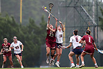 CHAPEL HILL, NC - MAY 12: Elon's Jacie Cooper (23) and Virginia's Maggie Jackson (14) challenge for the ball. The Elon University Phoenix played the University of Virginia Cavaliers on May 12, 2017, at Fetzer Field in Chapel Hill, NC in an NCAA Women's Lacrosse Tournament First Round match. Virginia won the game 11-9.