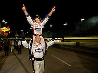 Jimmie Johnson, driver of the #48 Lowe's Chevrolet, celebrates his fouth consecutive series championship after the NASCAR Sprint Cup Series Ford 400 at Homestead-Miami Speedway on November 22, 2008 in Homestead, Florida.