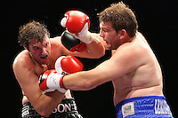 Tyson Fury (black shorts) defeats John McDermott in a Heavyweight Boxing contest for the English Title at the Brentwood International Centre, promoted by Maloney Promotions - 11/09/09 -