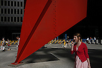 CHICAGO - JULY 11: Pedestrians walk past a huge red sculpture by Alexander Calder outisde the U S Post Office  on Wednesday, July 11, 2007 in downtown Chicago. (Photo by Landon Nordeman).