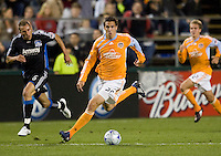 28 March 2009: Geoff Cameron of Dynamo dribbles the ball during the game against the Earthquakes at Buck Shaw Stadium in Santa Clara, California.  San Jose Earthquakes defeated Houston Dynamo, 3-2.