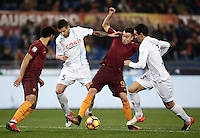Calcio, Serie A: Roma vs ChievoVerona. Roma, stadio Olimpico, 22 settembre 2016.<br /> Roma&rsquo;s Stephan El Shaarawy, second from right, is challenged by Chievo Verona's Alessandro Gamberini, second from left, and Dario Dainelli, right, as his teammate Mohamed Salah looks on during the Italian Serie A football match between Roma and Chievo Verona, at Rome's Olympic stadium, 22 December 2016.<br /> UPDATE IMAGES PRESS/Isabella Bonotto