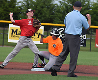 RICK PECK/SPECIAL TO MCDONALD COUNTY PRESS<br /> McDonald County second baseman Parker Toney forces out a runner from the Lawrence All-Stars before throwing to first for a try at a double play during McDonald County's 12-3 loss on July 8 in the Patriot Classic 18U Baseball Tournament in Fort Scott, Kan.