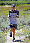 August 20, 2016 - Leadville, Colorado, U.S. -  Bend, Oregon runner, Ian Sharman #1, reaches the 65 mile Twin Lakes aid station on his way to defending his championship during the Blueprint for Athletes Leadville Trail 100, Leadville, Colorado.  Considered one of the most challenging endurance races in the world, ultra distance runners will navigate high altitude trails, challenging river crossings, and a variety of changing weather with an elevation gain of more than 18,000 feet ranging from 9200 feet near Twin Lakes to 12,600 feet atop the high point of Hope Pass.