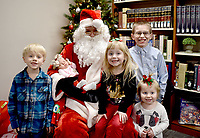 Courtesy photo<br /> The Cartwright family enjoys meeting Santa at a recent &ldquo;Book and A Bear&rdquo; event at the McDonald County Library in Pineville. Noah, Barrett, Adalyn, Abigail, and baby Chasidi Cartwright grinned for the camera at the December event that catapulted the library into uncharted waters of success. The Pineville and Southwest City library events drew 450 visitors, including 300 children. Youngsters had the opportunity to enjoy games, snacks and stories, have their photo taken with Santa and receive a free book and a bear. Three hundred books and bears were distributed.