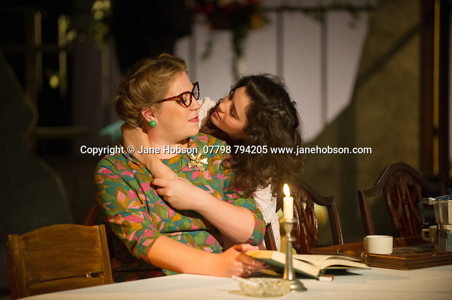 London, UK. 18.07.2014. Mountview Academy of Theatre Arts presents SATURDAY, SUNDAY, MONDAY by Eduardo de Filippo, the English adaptation by Keith Waterhouse & Willis Hall, directed by Michael Howcroft, at the Unicorn Theatre, as part of the Postgraduate Season 2014. Picture shows:  Sophie Napleton (Aunt Meme) and Amy Tobias (Guillianella). Photograph © Jane Hobson.