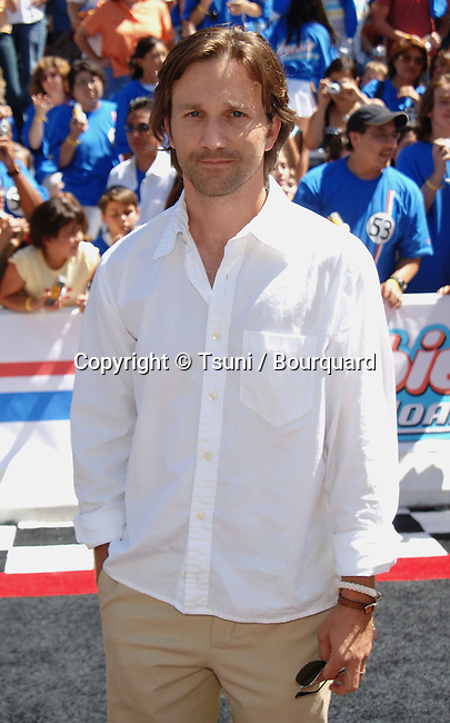 Breckin Meyer arriving at the HERBIE: Full Loaded Premiere at the El Capitan Theatre in Los Angeles. June 19, 2005.