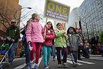 "These children were among hundreds of Seattle residents who marched from Westlake Center Park to the Seattle Center on January 13, 2013, calling for stricter regulations of firearms. Sponsored by a network of churches and other groups called ""Stand-up Washington,"" the demonstrators called for a state ban on semi-automatic weapons as well as stricter gun laws."