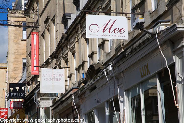 Specialist shopping shop signs Bartlett Street, Bath, Somerset, England