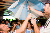 Argentina fans celebrate their team's victory against Mexico in a World Cup match on June 24, 2006 at Novecento, a New York City restaurant.<br /> <br /> The World Cup, held every four years in different locales, is the world's pre-eminent sports tournament in the world's most popular sport, soccer (or football, as most of the world calls it).  Qualification for the World Cup is open to any country with a national team accredited by FIFA, world soccer's governing body. The first World Cup, organized by FIFA in response to the popularity of the first Olympic Games' soccer tournaments, was held in 1930 in Uruguay and was participated in by 13 nations.    <br /> <br /> As of 2010 there are 208 such teams.  The final field of the World Cup is narrowed down to 32 national teams in the three years preceding the tournament, with each region of the world allotted a specific number of spots.  <br /> <br /> The World Cup is the most widely regularly watched event in the world, with soccer teams being a source of national pride.  In most nations, the whole country is at a standstill when their team is playing in the tournament, everyone's eyes glued to their televisions or their ears to the radio, to see if their team will prevail.  While the United States in general is a conspicuous exception to the grip of World Cup fever there is one city that is a rather large exception to that rule.  In New York City, the most diverse city in a nation of immigrants, the melting pot that is America is on full display as fans of all nations gather in all possible venues to watch their teams and celebrate where they have come from.