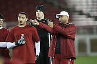 """9 February 2007: David Shaw talks with Michael Miller and Evan Moore during a """"Friday Night Lights"""" practice at Stanford Stadium in Stanford, CA."""