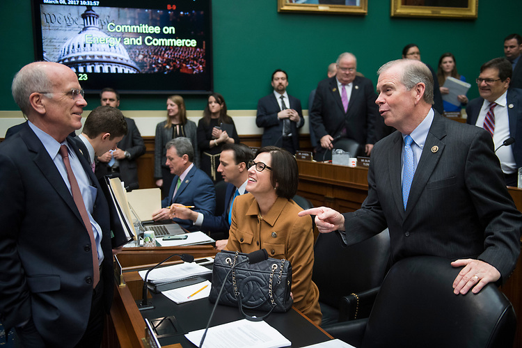 UNITED STATES - MARCH 8: From left, Reps. Peter Welch, D-Vt., Mimi Walters, R-Calif., and Tim Walberg, R-Mich., talk before an Energy and Commerce Committee markup in Rayburn Building of the bill to repeal and replace the Affordable Care Act, March 8, 2017. (Photo By Tom Williams/CQ Roll Call)