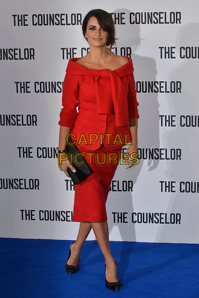 Penelope Cruz <br /> 'The Counselor' photocell at The Dorchester Hotel, London, England.<br /> 5th October 2013<br /> full length red jacket off the shoulder knotted black shoes clutch bag skirt<br /> CAP/PL<br /> &copy;Phil Loftus/Capital Pictures