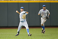 UCLA outfielder Christoph Bono (3) prepares to make a throw from the outfield as teammate Brian Carroll (24) shouts instructions during Game 1 of the 2013 Men's College World Series Finals against the Mississippi State Bulldogs on June 24, 2013 at TD Ameritrade Park in Omaha, Nebraska. The Bruins defeated the Bulldogs 3-1, taking a 1-0 lead in the best of 3 series. (Andrew Woolley/Four Seam Images)
