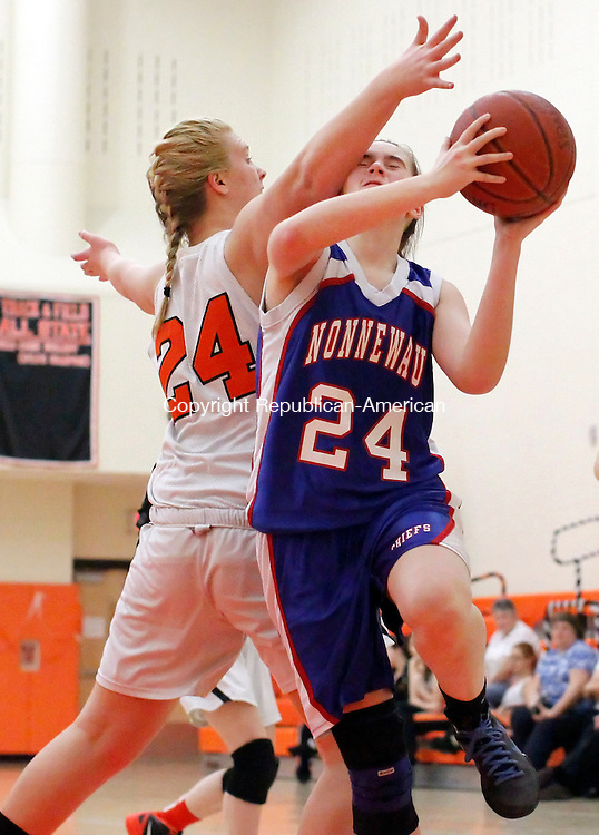 Terryville, CT-13 February 2012-021312CM11-  Nonnewaug's Abby Charette scores two against Terryville's Liz Klopp during their Berkshire League matchup Monday night in Terryville.    Christopher Massa Republican-American