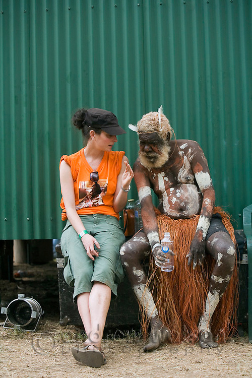 Indigenous dancer and caucasian woman at the Laura Aboriginal Dance Festival.  Laura, Queensland, Australia