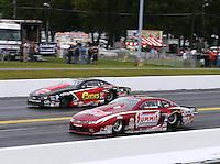 Oct 2, 2016; Mohnton, PA, USA; NHRA pro stock driver Greg Anderson (near) races alongside John Gaydosh during the Dodge Nationals at Maple Grove Raceway. Mandatory Credit: Mark J. Rebilas-USA TODAY Sports