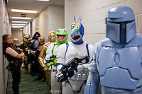 ORLANDO, FLORIDA - AUG 24: Star Wars fans take part in the 6th bi-annual Star Wars Celebration at The Orange County Convention Center on Friday, August 24, 2012 in Orlando, Florida. Pictured backstage during a costume contest are contestants waiting to go on stage. Muppet Troopers: Gonzo the Great (Mike Lica 734 765 6181) and Kermit the Frog (Derek Lane-Waters 248 375 5563). Also pictured: C3P0: Danny Jones, 27, his wife Audrey Jones, 26, holding their son Parker Jones, 18 months. (801-633-2762) (Photo by Landon Nordeman)