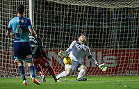 Goalkeeper Scott Brown of Wycombe Wanderers makes a save from George Thomas of Coventry City during the The Checkatrade Trophy Southern Group D match between Wycombe Wanderers and Coventry City at Adams Park, High Wycombe, England on 9 November 2016. Photo by Andy Rowland.