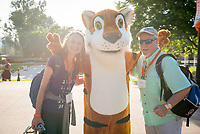 Anita Johnson P'21 and Brian Johnson P'21 pose for a photo with Oswald. Occidental College celebrates Homecoming and Family Weekend on Saturday, Oct. 14, 2017 at Oswald's Homecoming Party in the Academic Quad, featuring games, activity booths, a pub and food.<br /> (Photo by Marc Campos, Occidental College Photographer)
