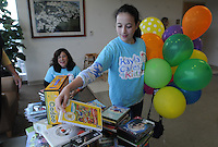 NWA Democrat-Gazette/FLIP PUTTHOFF <br /> Kayla Abramowitz, 13, (right) and her mom, Andrea Abramowitz look at some of the items donated Saturday Sept. 19 2015 to Mercy Hospital in Rogers through the Kayla Cares 4 Kids organization. Kayla is founder of the Kayla Cares 4 Kids, which has contributed items to hospitals across the nation for children to play with during their hospital stays. Kayla also brought balloons to give to young patients on Saturday.