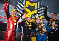 Oct 14, 2018; Concord, NC, USA; (From left) NHRA pro stock motorcycle rider Matt Smith, top fuel driver Steve Torrence, funny car driver Ron Capps and pro stock driver Jason Line celebrate after winning the Carolina Nationals at zMax Dragway. Mandatory Credit: Mark J. Rebilas-USA TODAY Sports