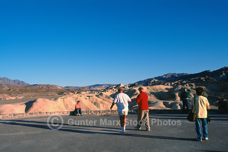 Death Valley National Park, California, CA, USA - Tourists admiring View of Eroded Landscape and Mountains, from Zabriskie Point in the Amargosa Range