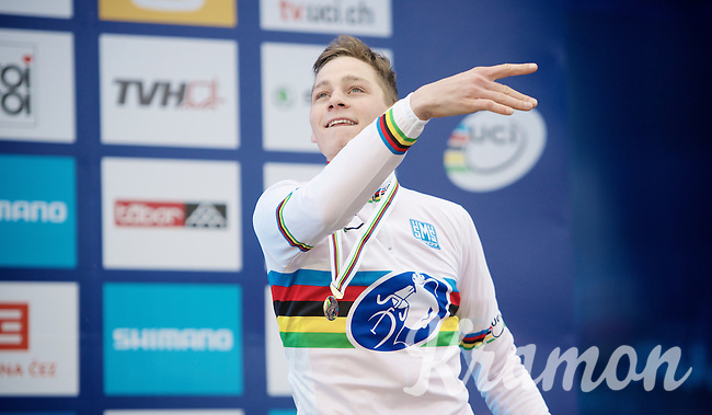 Mathieu Van der Poel (NLD) throwing his podium flowers into the crowd<br /> <br /> Elite Men's race<br /> <br /> 2015 UCI World Championships Cyclocross <br /> Tabor, Czech Republic