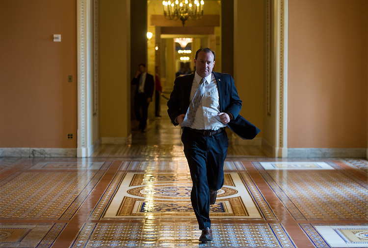 UNITED STATES - MARCH 11: Sen. Mike Lee, R-Utah, runs to the Senate floor for a vote on Tuesday, March 11, 2014. (Photo By Bill Clark/CQ Roll Call)