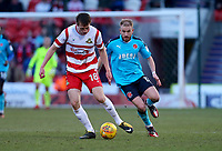 Bobby Grant of Fleetwood Town loses the ball against George Glendon of Fleetwood Town during the Sky Bet League 1 match between Doncaster Rovers and Fleetwood Town at the Keepmoat Stadium, Doncaster, England on 17 February 2018. Photo by Leila Coker / PRiME Media Images.