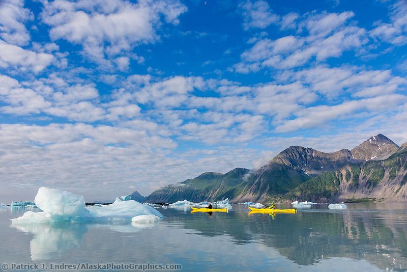 Sea kayaking among icebergs in Bear Glacier Lagoon, Kenai Fjords National Park, southcentral, Alaska.