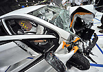 """July 21st, 2011, Susonosi, Japan - A Toyota VITZ is badly damaged after a head-on collision with a Toyota Crown at the speed of 55km/h (about 34 miles/h) in a demonstration at Toyotas Higashi-Fuji Technical Center on the foot of Mt. Fuji, some 92km (about 57 miles) southwest of Tokyo, on Thursday, July 21, 2011. Toyota showed to reporters technologies aimed at increasing safety for pedestrians and elderly drivers, as part of its initiatives to eliminate traffic casualties. The technologies include a Pre-Collision System with collision-avoidance assist, glare-preventing adaptive driving beams and a pop-up hood for lessening pedestrian injury. In the PCS, Toyota uses cameras and a super sensitive radar called """"millimeter-wave,"""" both installed in the front of the vehicle, to detect possible crashes such as a pedestrian crossing the road. Then the vehicle calculates how braking and steering must be applied to avoid a crash. (Photo by Natsuki Sakai/AFLO) [3615] -mis-"""