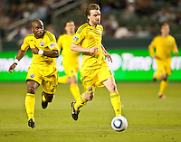 CARSON, CA – APRIL 9, 2011: Columbus Crew defender Julius James (26) and midfielder Eddie Gaven (12) move the ball up the field during the match between Chivas USA and Columbus Crew at the Home Depot Center, April 9, 2011 in Carson, California. Final score Chivas USA 0, Columbus Crew 0.
